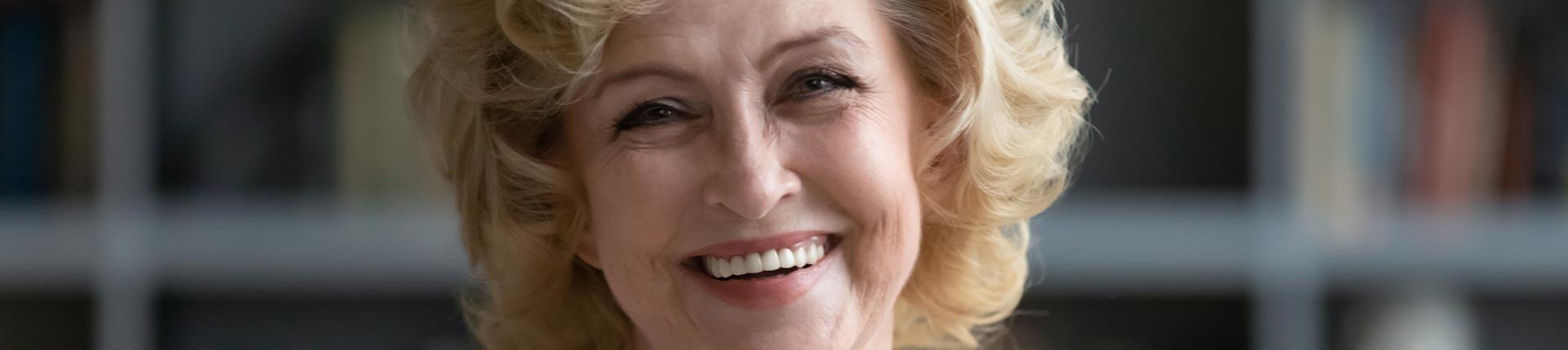 Happy elderly woman after having endodontic surgery