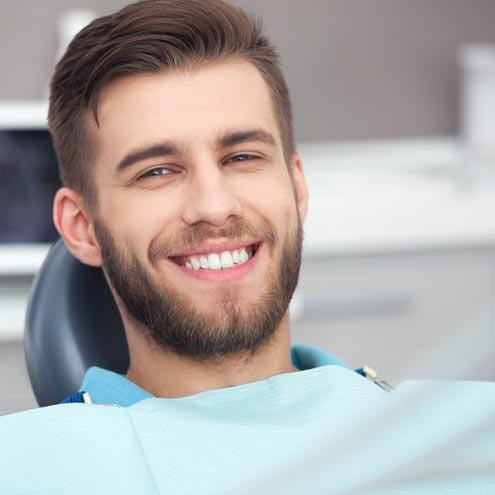 Man sitting on dental chair