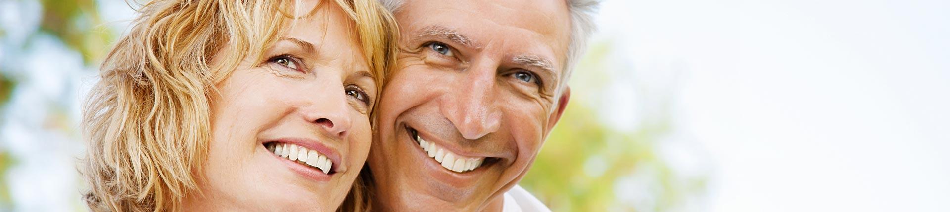 Happy senior couple after having endodontics treatment